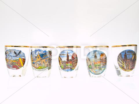 Stock photo of five packe shot glasses of strasbourg landmark isolated on white background