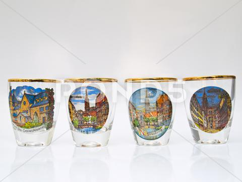 Stock photo of four packe shot glasses of strasbourg landmark isolated on white background
