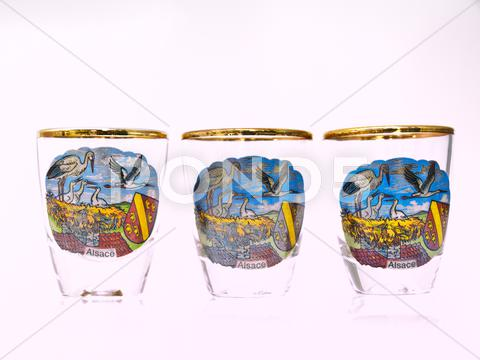 Stock photo of three packe shot glasses of strasbourg landmark isolated on white background