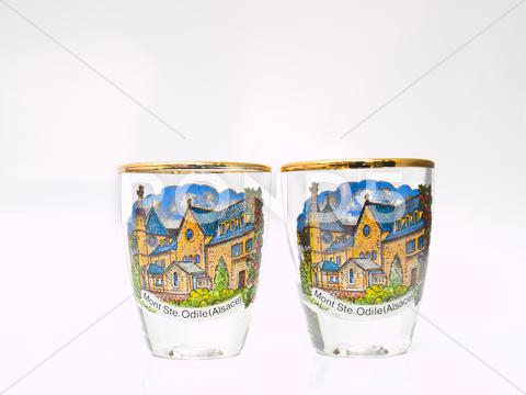 Stock photo of a couple packe shot glasses of strasbourg landmark isolated on white backgrou