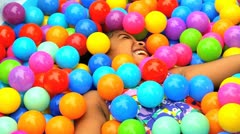 Little Ethnic Girl in Ball Pool Stock Footage