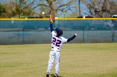 Youth outfielder catching ball Stock Photos