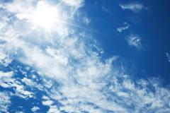 bright blue sky with the sun - stock photo