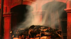 Ceremonial fire out of temple in nepal Stock Footage