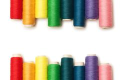 Rainbow colored threads set isolated over white background Stock Photos