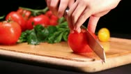 Slicing tomato on cutting board Stock Footage