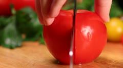 Slicing fresh tomato - stock footage