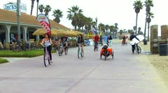 Bicycles, Recumbent Bike Past Beach Cafe in Huntington Beach, CA Stock Footage