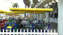 Bike Surreys And Bicycles For Rent On Huntington Beach CA Stock Footage