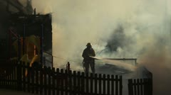 Fighting fire on playground - stock footage