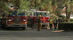 Fire trucks and fire fighters - stock footage