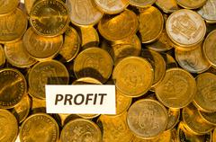 Profit sign at a stack of golden coins Stock Photos