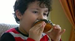 Little boy likes donut Stock Footage
