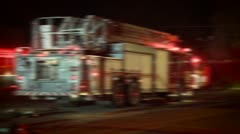 FIRE TRUCK AT NIGHT WITH FLASHING LIGHTS AND SIREN AND BLURRED OUT HD 1080 VIDEO - stock footage