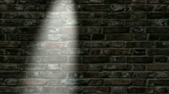 Spotlight moves across brick wall Stock Footage