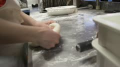 Young Woman Forming and Rolling Out a Dough Ball for Pizza Crust Stock Footage