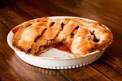 Freshly baked apple pie with a missing portion Stock Photos