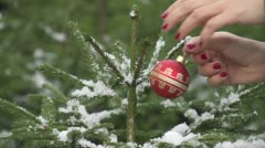 SLOW MOTION: Decorating Christmas tree in nature - stock footage