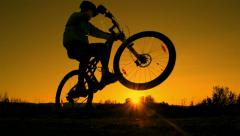 SLOW MOTION: mountain biker riding wheelie - stock footage