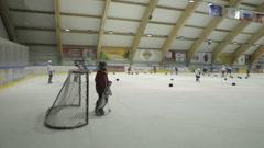 Coaching children's hockey team. - stock footage