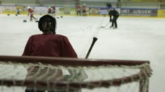 Coaching children's hockey team. - stock footage