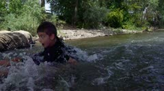 action shot of youth tubing down the river - stock footage