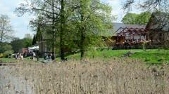 People resting near galve lake in trakai. zorb bubble on water Stock Footage
