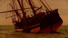 Square rigger hard aground Stock Footage