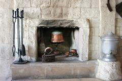 Fire-place in old house Stock Photos