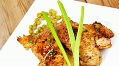 Quarter chicken garnished with green sweet peas Stock Footage
