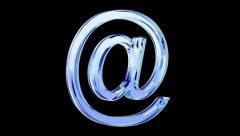 Blue glass e-mail symbol loop rotate on black background Stock Footage