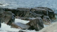 Stock Video Footage of Waves Hitting Rocks Shallow Depth of Field
