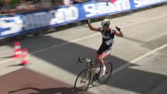 Individual cyclist reaches the finish line Stock Footage