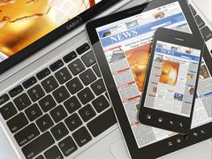 Digital news. laptop, mobile phone and digital tablet pc. 3d Stock Illustration