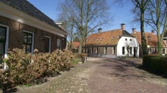 Pan + hold radial village of Niehove built on a mound, The Netherlands Stock Footage