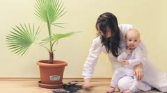 Mother making clean the mess, baby going guilty Stock Footage