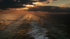 Sunset and wake of a ship - stock footage