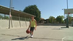 Boy dribbles basketball shoots ball and misses Stock Footage