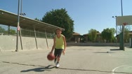 Stock Video Footage of Boy dribbles basketball shoots ball and misses