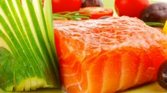 Salmon fillet with vegetables and rosemary Stock Footage