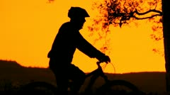 PORTRAIT: Mountain biker silhouette Stock Footage