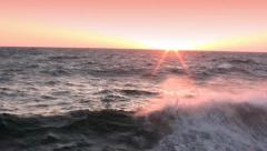 Spatter of waves at sunset - stock footage