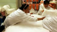 Stock Video Footage of Workers creating a silk mattress