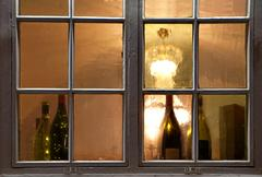 Window with wine bottles Stock Photos