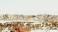 Excavator works on a garbage dump Stock Footage