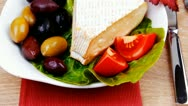 Stock Video Footage of brie cheese on salad in white dish