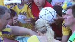 Female football player (celebrity, star) signing autographs for soccer fans Stock Footage