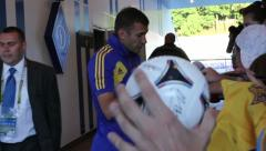 Famous football player signs autographs after soccer match Stock Footage