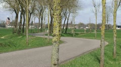 Winding road in Dutch polder landscape at Niehove, province of Groningen Stock Footage