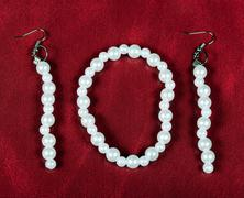 Bracelet and earrings of pearls. bijouterie Stock Photos